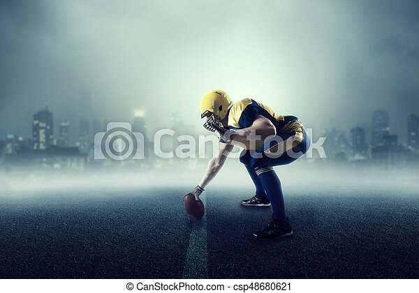 American football player, cityscape on background - csp48680621