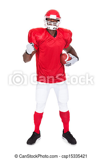 American Football Player Holding Rugby Ball - csp15335421