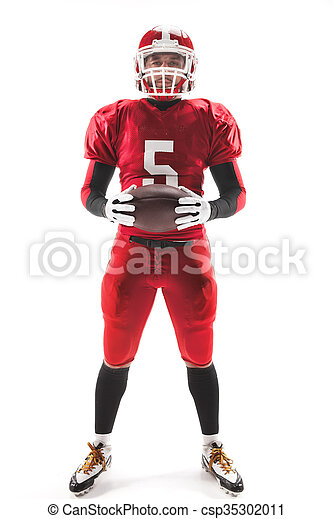 American football player posing with ball on white background - csp35302011