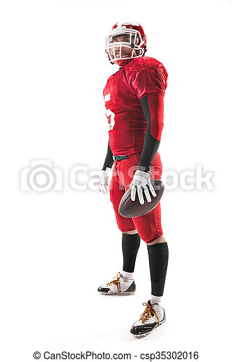 American football player posing with ball on white background - csp35302016