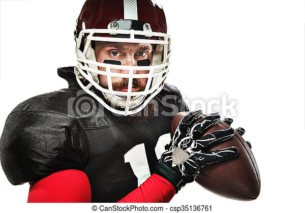 American football player posing with ball on white background - csp35136761