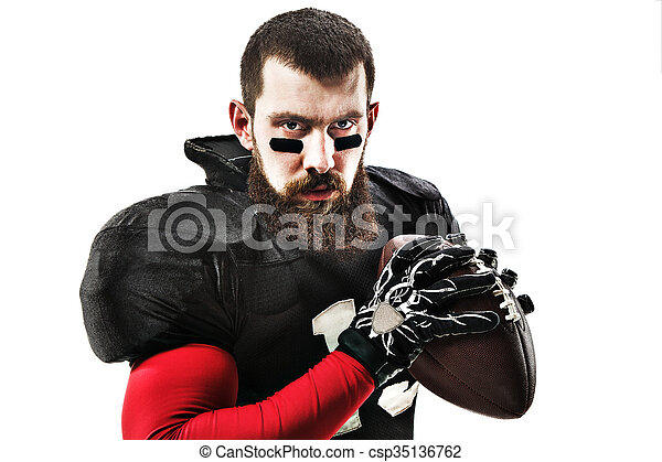 American football player posing with ball on white background - csp35136762