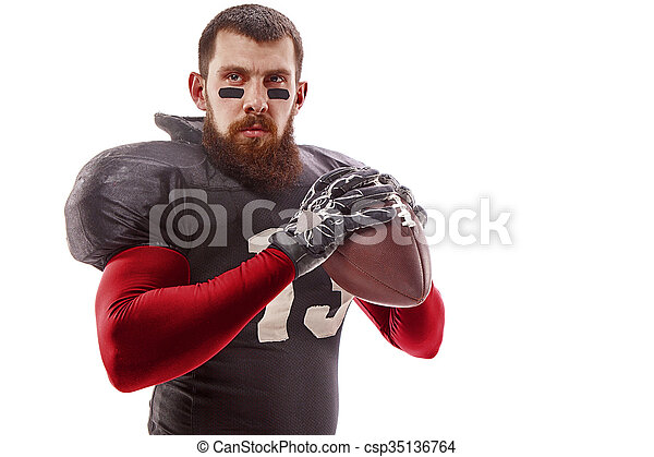 American football player posing with ball on white background - csp35136764