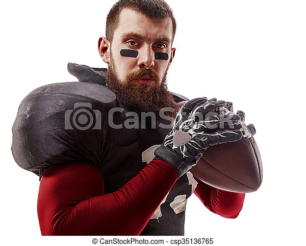 American football player posing with ball on white background - csp35136765