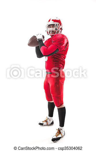 American football player posing with ball on white background - csp35304062