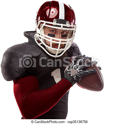 American football player posing with ball on white background - csp35136756
