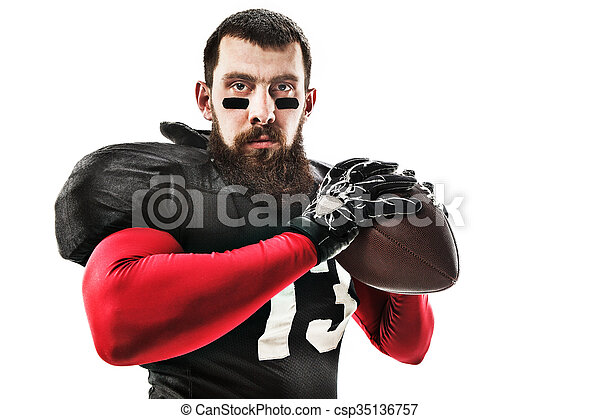American football player posing with ball on white background - csp35136757