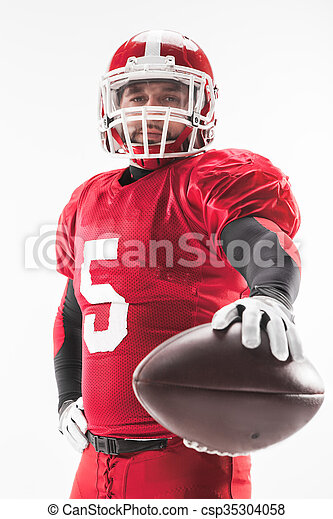 American football player posing with ball on white background - csp35304058