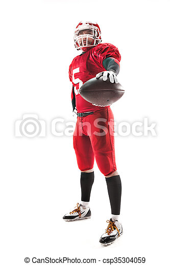 American football player posing with ball on white background - csp35304059