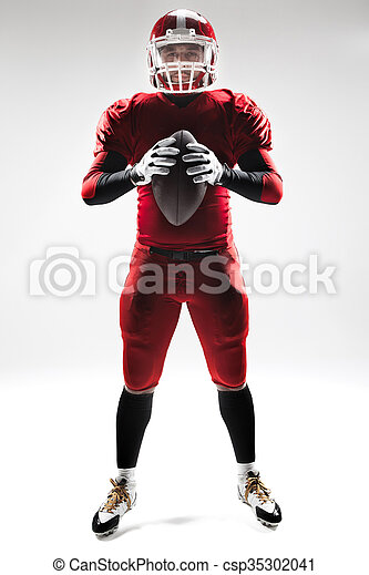 American football player posing with ball on white background - csp35302041