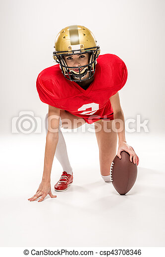 american football player posing with ball - csp43708346
