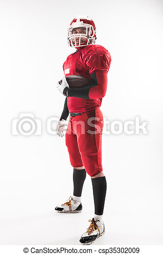 American football player posing with ball on white background - csp35302009
