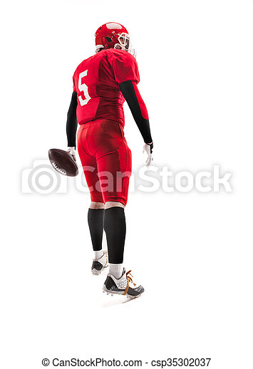 American football player posing with ball on white background - csp35302037