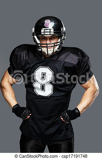 American football player wearing helmet and black jersey with ...