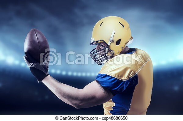 American football player with ball on sport arena - csp48680650