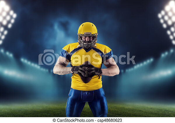 American football player with ball on the stadium - csp48680623