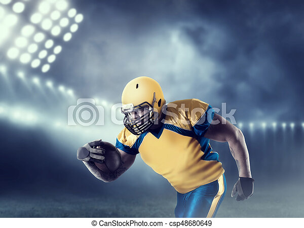 American football player with ball on sport arena - csp48680649