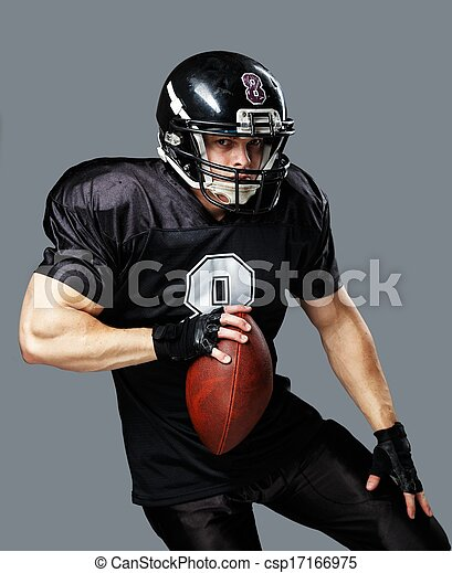 American football player with ball wearing helmet and jersey  - csp17166975