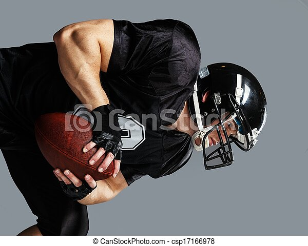 American football player with ball wearing helmet and jersey  - csp17166978