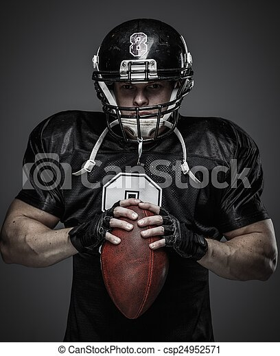 American football player with ball  - csp24952571