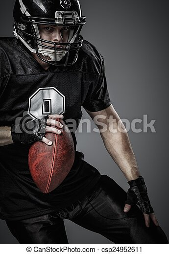 American football player with ball  - csp24952611