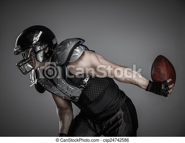 American football player with ball  - csp24742586