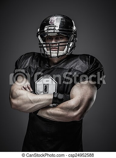 American football player with ball  - csp24952588