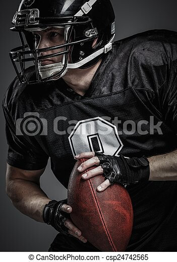 American football player with ball  - csp24742565