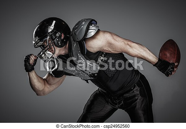 American football player with ball  - csp24952560