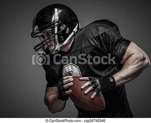 American football player with ball  - csp24742546