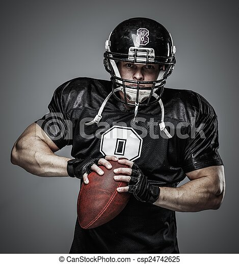 American football player with ball  - csp24742625