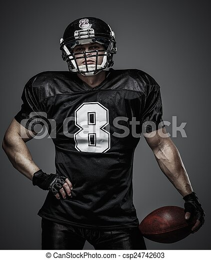 American football player with ball  - csp24742603