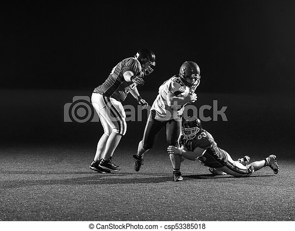 American football players in action - csp53385018
