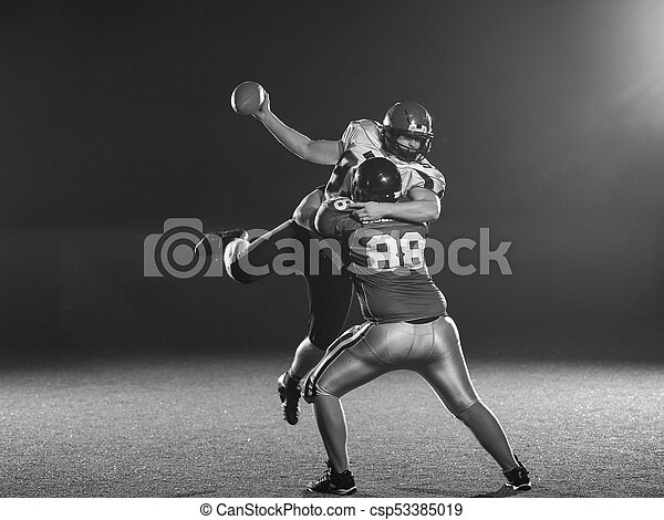 American football players in action - csp53385019