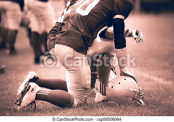 American football players in action - csp58506064
