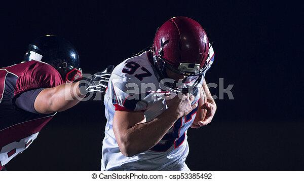 American football players in action - csp53385492