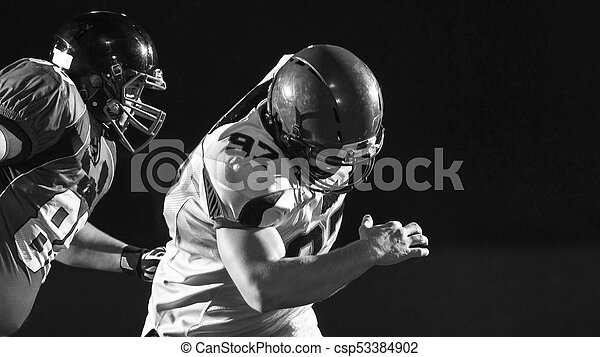 American football players in action - csp53384902