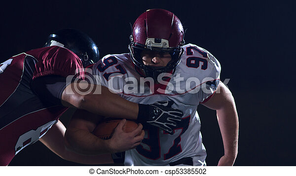 American football players in action - csp53385502
