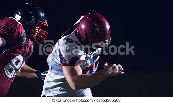 American football players in action - csp53385503