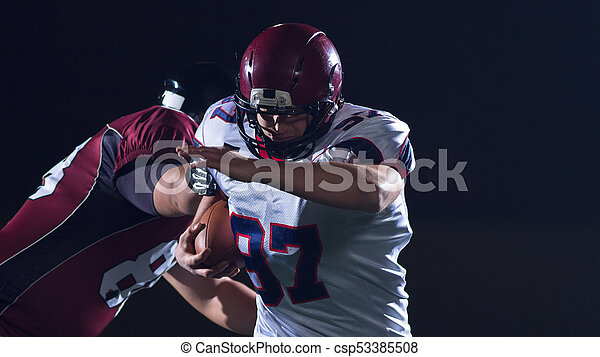 American football players in action - csp53385508