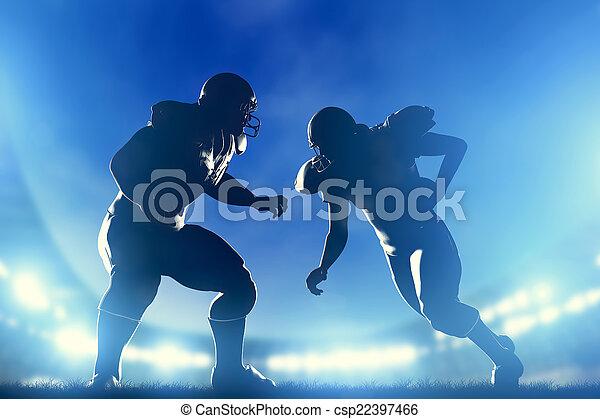American football players in game, quarterback running. Stadium lights - csp22397466
