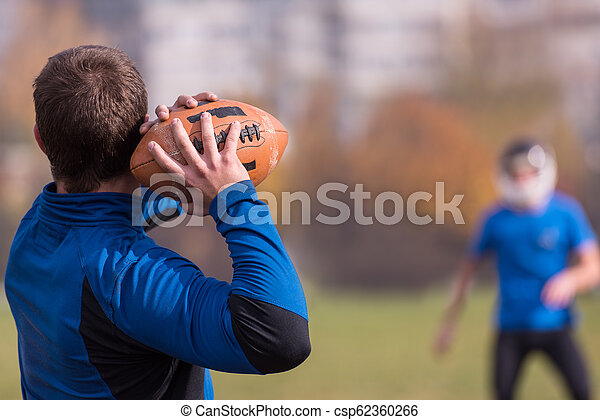 american football team with coach in action - csp62360266