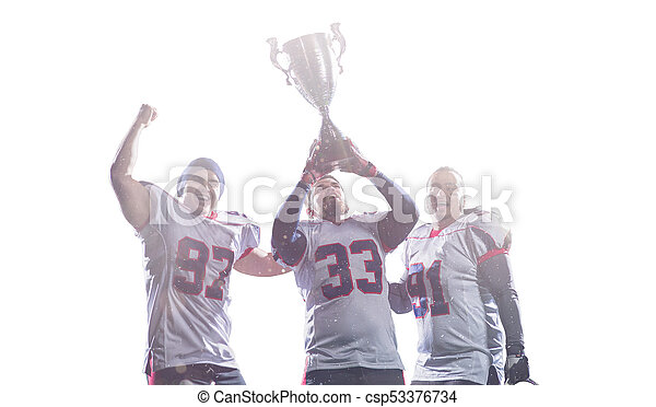 american football team with trophy celebrating victory - csp53376734