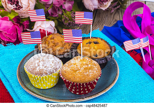 American independence day, celebration, patriotism  concept - muffins, decorated with flag  for 4th july party. - csp48425487