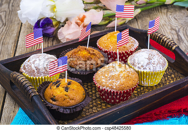 American independence day, celebration, patriotism  concept - muffins, decorated with flag  for 4th july party. - csp48425580