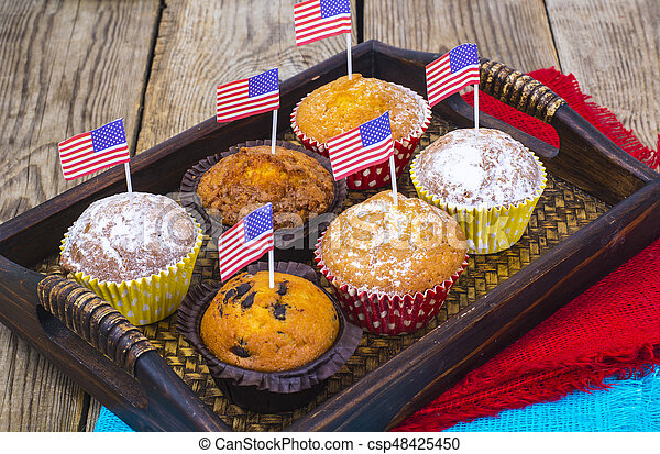 American independence day, celebration, patriotism  concept - muffins, decorated with flag  for 4th july party. - csp48425450
