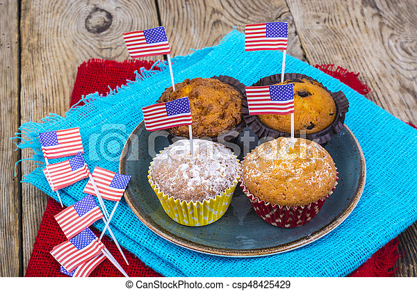 American independence day, celebration, patriotism  concept - muffins, decorated with flag  for 4th july party. - csp48425429