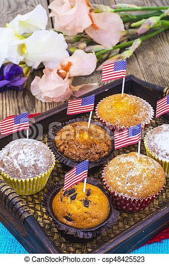 American independence day, celebration, patriotism  concept - muffins, decorated with flag  for 4th july party. - csp48425523
