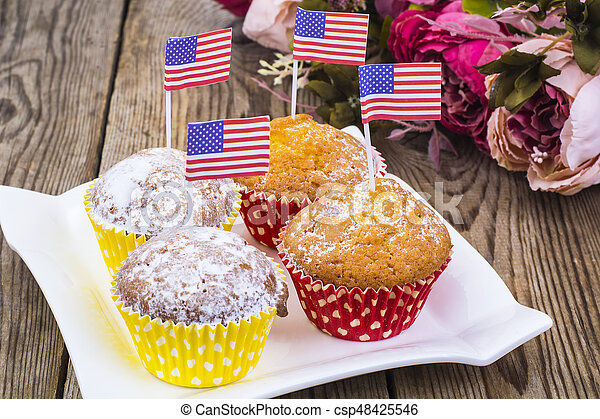 American independence day, celebration, patriotism  concept - muffins, decorated with flag  for 4th july party. - csp48425546