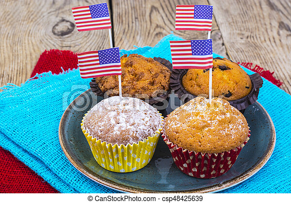 American independence day, celebration, patriotism  concept - muffins, decorated with flag  for 4th july party. - csp48425639